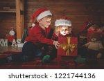 happy family in christmas night.... | Shutterstock . vector #1221744136