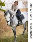 young woman with a horse for a... | Shutterstock . vector #1221775630