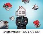 a businessman with a house... | Shutterstock . vector #1221777130