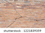 brick building with cracked... | Shutterstock . vector #1221839359