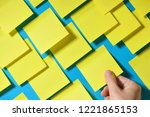 hand holding post it note on... | Shutterstock . vector #1221865153