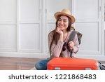 young asian woman traveler... | Shutterstock . vector #1221868483