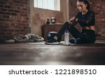 fit young woman sitting on a... | Shutterstock . vector #1221898510