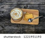 cup of coffee on wooden... | Shutterstock . vector #1221951193