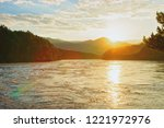 sunset above altai mountains... | Shutterstock . vector #1221972976