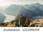 hiker watching to sun at... | Shutterstock . vector #1221998299
