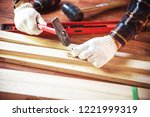 building diy with hammer while... | Shutterstock . vector #1221999319
