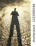 A Man's Shadow On Dry Soil