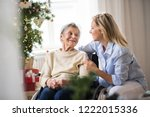 a senior woman in wheelchair... | Shutterstock . vector #1222015336
