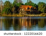 beautiful house reflected in... | Shutterstock . vector #1222016620