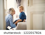 a young mother talking to her... | Shutterstock . vector #1222017826