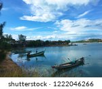 three old boats on the water ... | Shutterstock . vector #1222046266