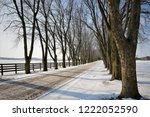 a tree lined driveway in a farm ... | Shutterstock . vector #1222052590