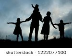 silhouette of a happy family... | Shutterstock . vector #1222077100