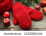 knitted red gloves with... | Shutterstock . vector #1222082146