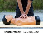male instructor showing cpr on... | Shutterstock . vector #122208220