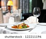 Stock photo classic dinner setting in the restaurant 122211196