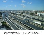 aerial view of traffic driving... | Shutterstock . vector #1222115233