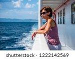 woman standing on a ship deck... | Shutterstock . vector #1222142569