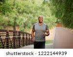 mature man walking in the park.   Shutterstock . vector #1222144939