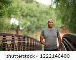 mature man walking in the park.   Shutterstock . vector #1222146400