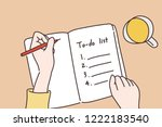 a hand writing a to do list in... | Shutterstock .eps vector #1222183540