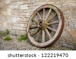 An Old Wooden Wagon Wheel...