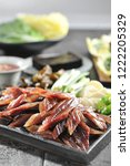 cooked dried fish on a plate | Shutterstock . vector #1222205329