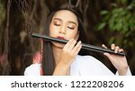 chinese girl is playing the... | Shutterstock . vector #1222208206