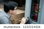 young asian male technician... | Shutterstock . vector #1222214326