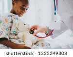 doctor playfully checking the... | Shutterstock . vector #1222249303