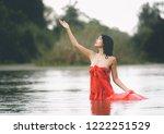 an asian woman in red bathrobe... | Shutterstock . vector #1222251529