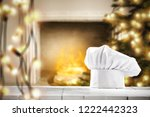 white cook hat on white wooden...   Shutterstock . vector #1222442323