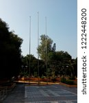 three of flagpoles at the park   Shutterstock . vector #1222448200