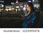 young caucasian woman texting...   Shutterstock . vector #1222455376