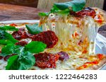 pizza slice melted cheese | Shutterstock . vector #1222464283