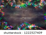 christmas fairy lights on wood. ... | Shutterstock . vector #1222527409