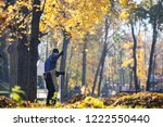 a man janitor works in the park ... | Shutterstock . vector #1222550440