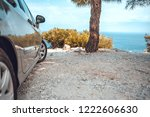 car parked in the shade of pine ...   Shutterstock . vector #1222606630