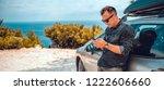man wearing black denim shirt...   Shutterstock . vector #1222606660
