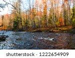 autumn forest river landscape.... | Shutterstock . vector #1222654909