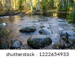 autumn forest river stones view....   Shutterstock . vector #1222654933