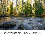 autumn forest river stones view....   Shutterstock . vector #1222654936