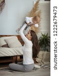 mother lifted son in the air... | Shutterstock . vector #1222679473