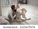 mom supports baby son swinging...   Shutterstock . vector #1222679476