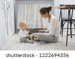 mom and baby playing together... | Shutterstock . vector #1222694356