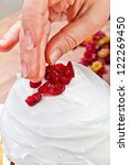 Christmas creamy cake decorated by hands - stock photo