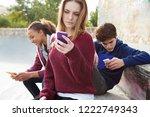 group of teenagers relaxing... | Shutterstock . vector #1222749343