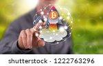 man touching a bitcoin rise... | Shutterstock . vector #1222763296