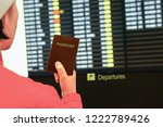 woman in airport  holding... | Shutterstock . vector #1222789426